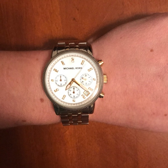 6016fa8a91fc Michael Kors Watch  two tone silver and gold. M 5ad557a43800c5af203b3832